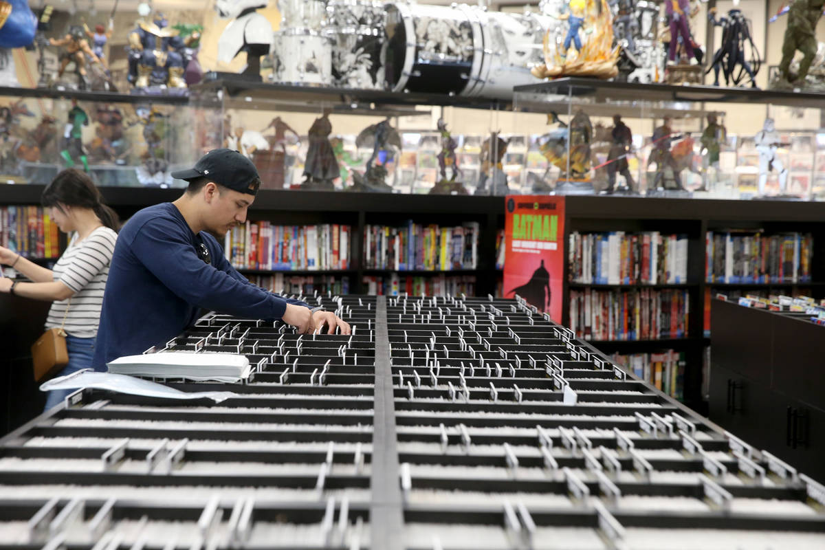 Vanessa Rodriguez and Tony Martinez, both of Fresno, California, browse for comics before a vis ...