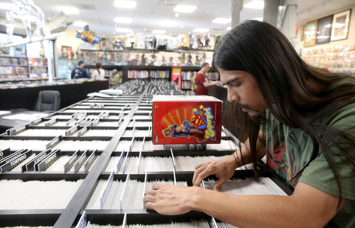 Arick Hortizuela of Henderson browses for comics before a visit by DJ Steve Aoki for a signing ...