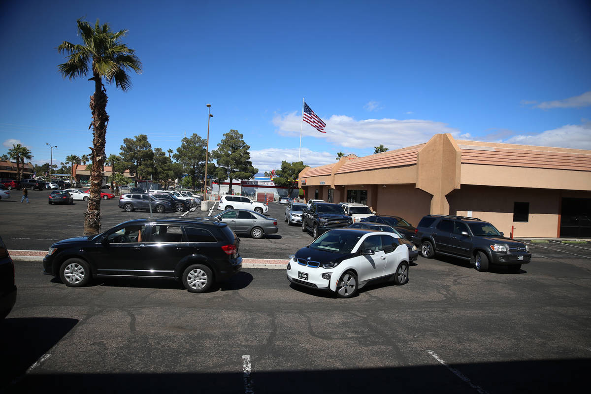 People line up to leave a swab sample at the Sahara Urgent Care & Wellness center in Las Ve ...