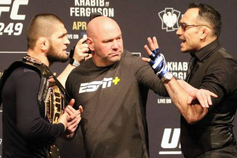 UFC lightweight champion Khabib Nurmagomedov, left, engages in a face off with Tony Ferguson, ...
