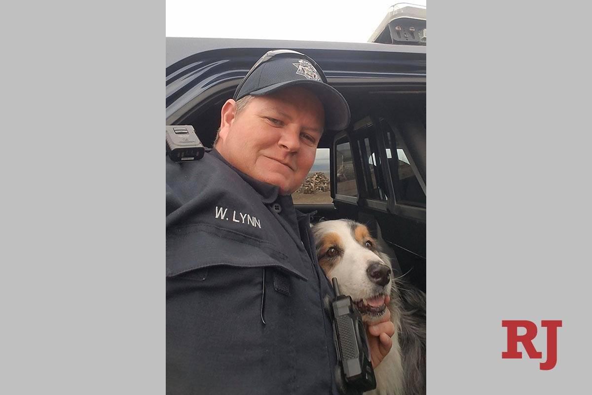 Nevada Highway Patrol Trooper W. Lynn with rescued dog, Tucker. (NHP Twitter post)