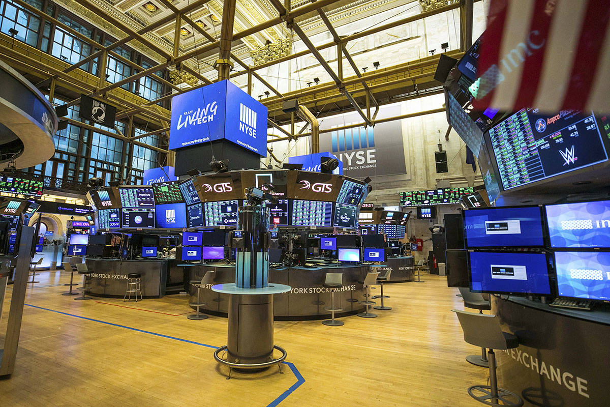 This photo provided by the New York Stock Exchange shows the unoccupied NYSE trading floor, clo ...