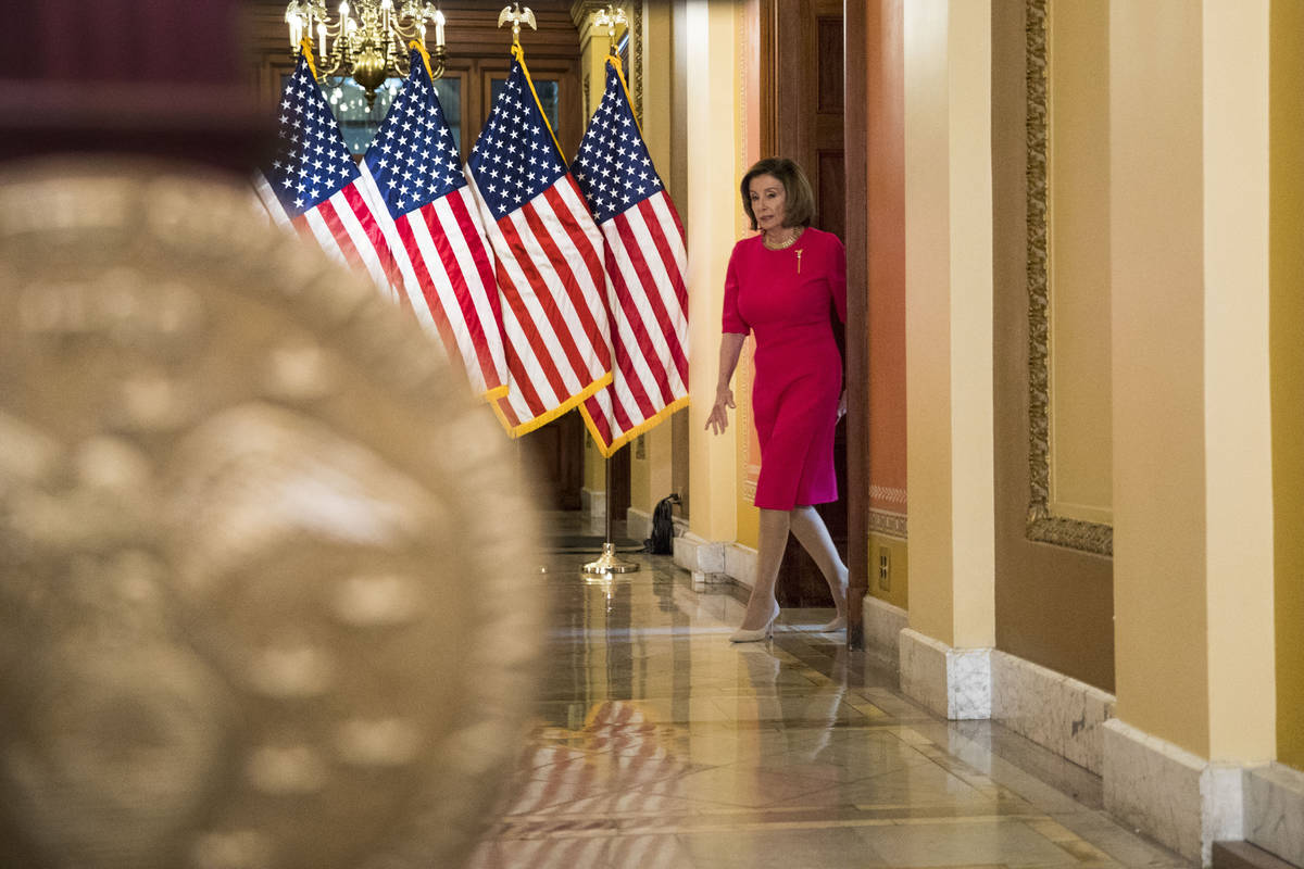 House Speaker Nancy Pelosi of Calif. arrives to read a statement outside her office on Capitol ...