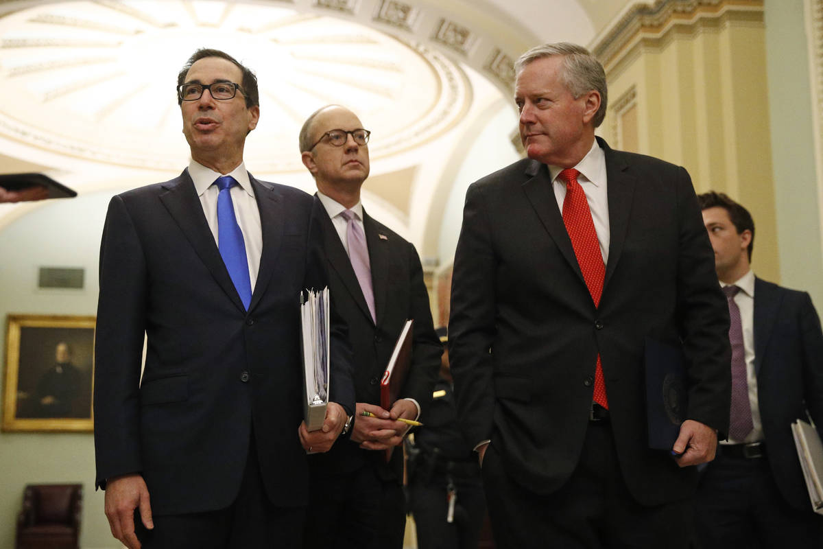 Treasury Secretary Steven Mnuchin, left, accompanied by White House Legislative Affairs Directo ...