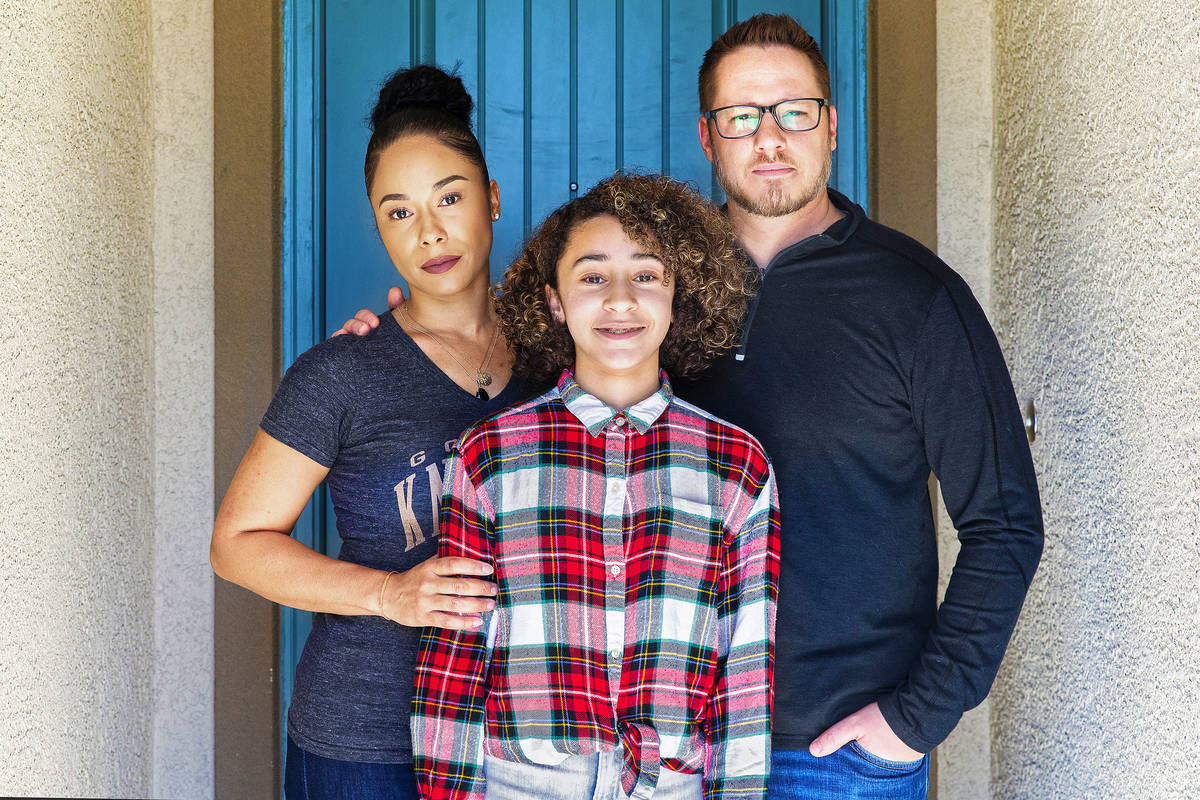 Jason and Erika Reed, with daughter Madison at their home in North Las Vegas on Tuesday, March ...