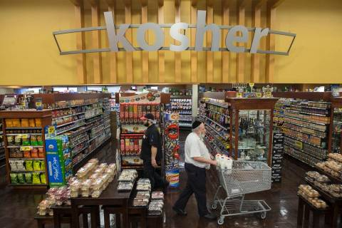 Customers shop in the Kosher Experience section at Smith's at 2211 N. Rampart Blvd. (Benjamin H ...