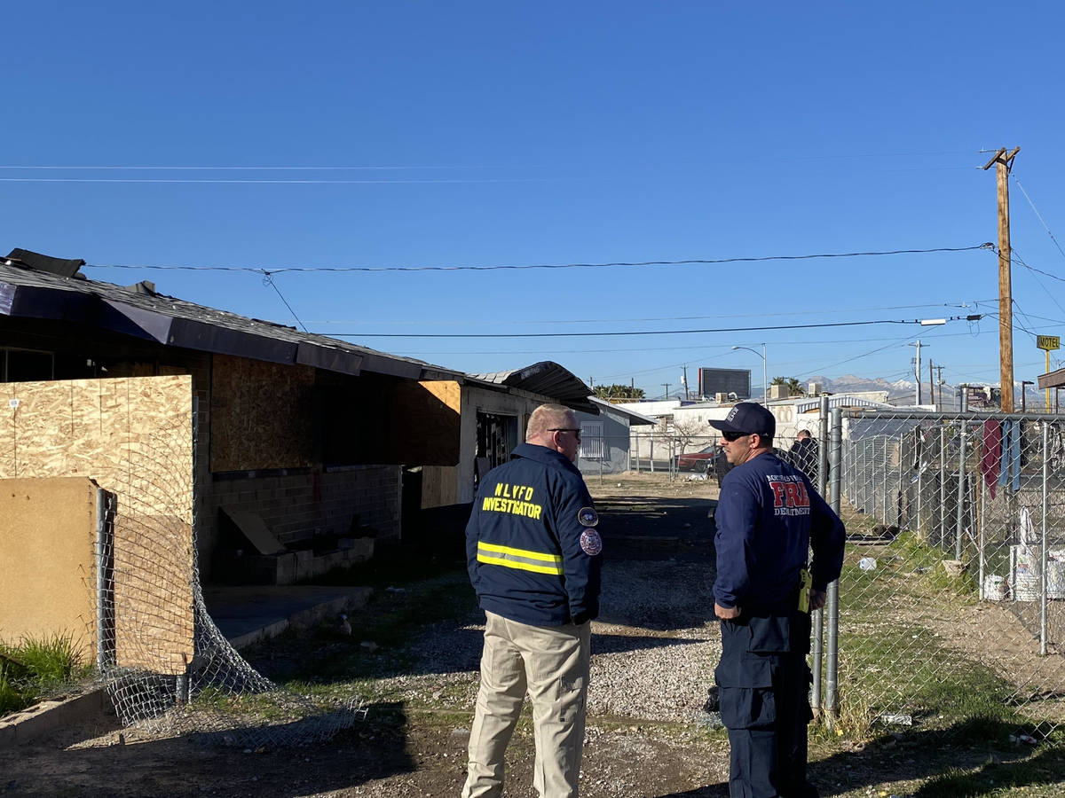 North Las Vegas police and fire inspectors investigate a fatal fire on Friday, Feb. 7, 2020, at ...