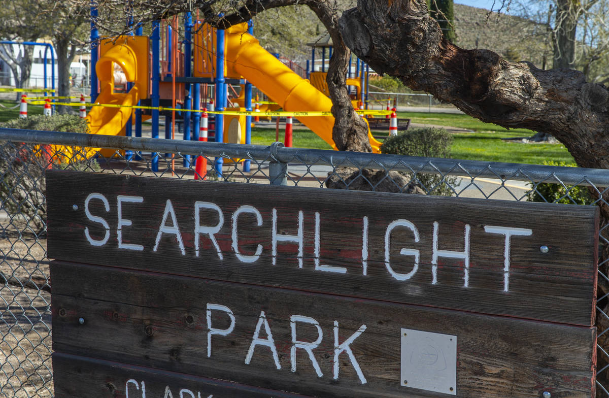 Searchlight Park is still open but the playground equipment closed off due to the coronavirus p ...