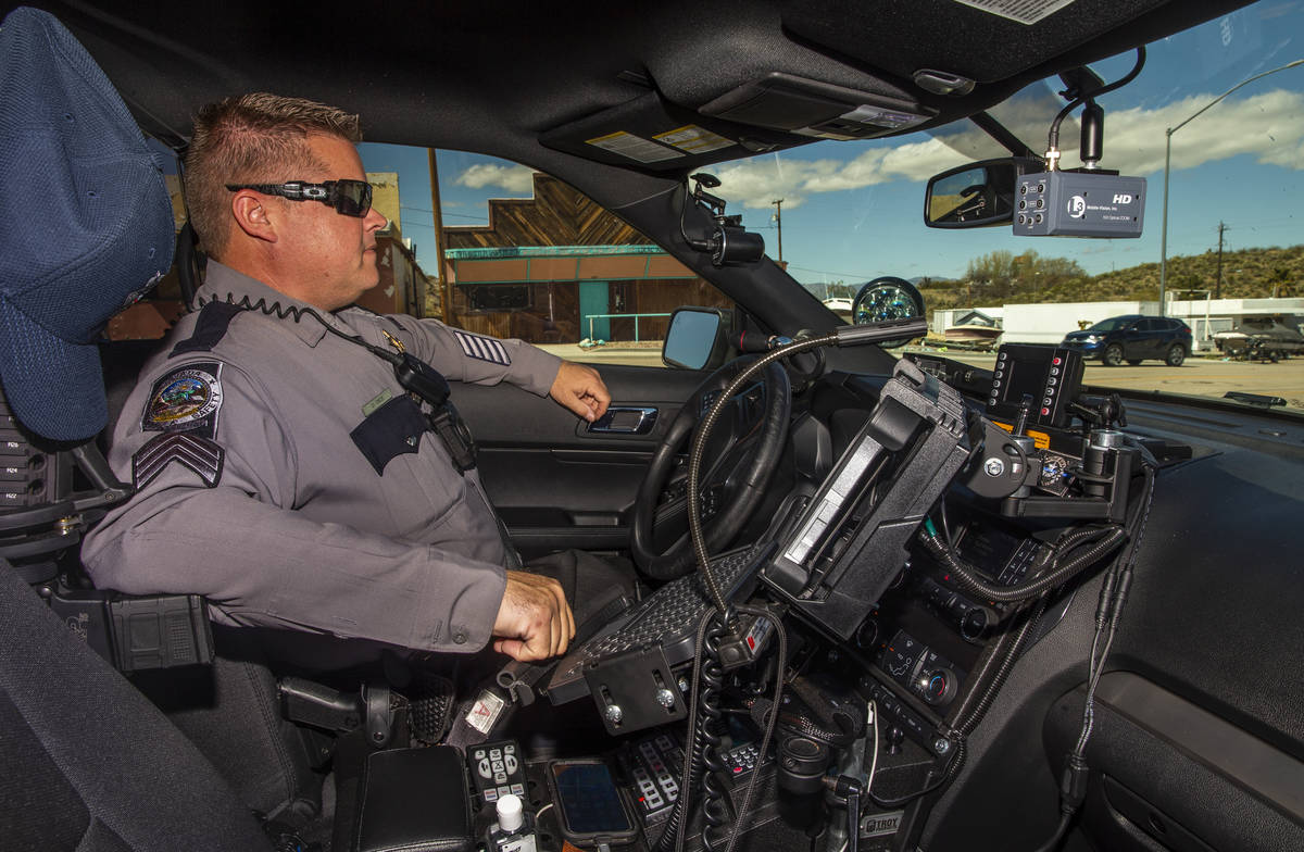 Nevada State Trooper Sgt. Wayne Dice monitors traffic speeds along U.S. 95 on Tuesday, March 24 ...