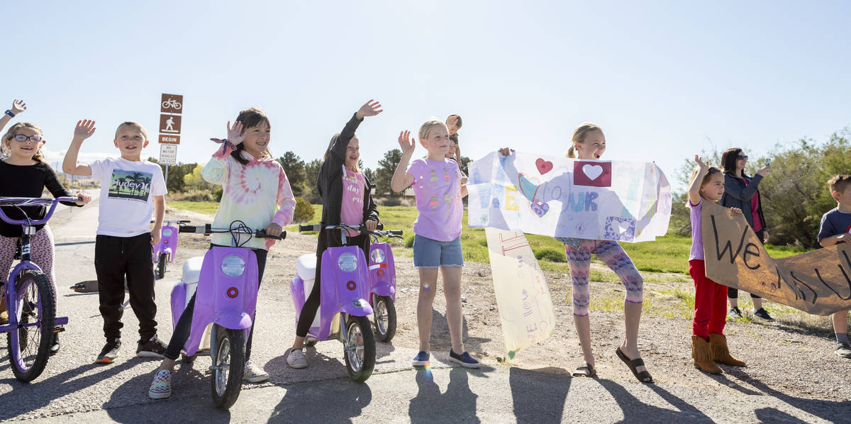 Grant M. Bowler elementary students wave to their teachers during a teacher parade in Logandale ...