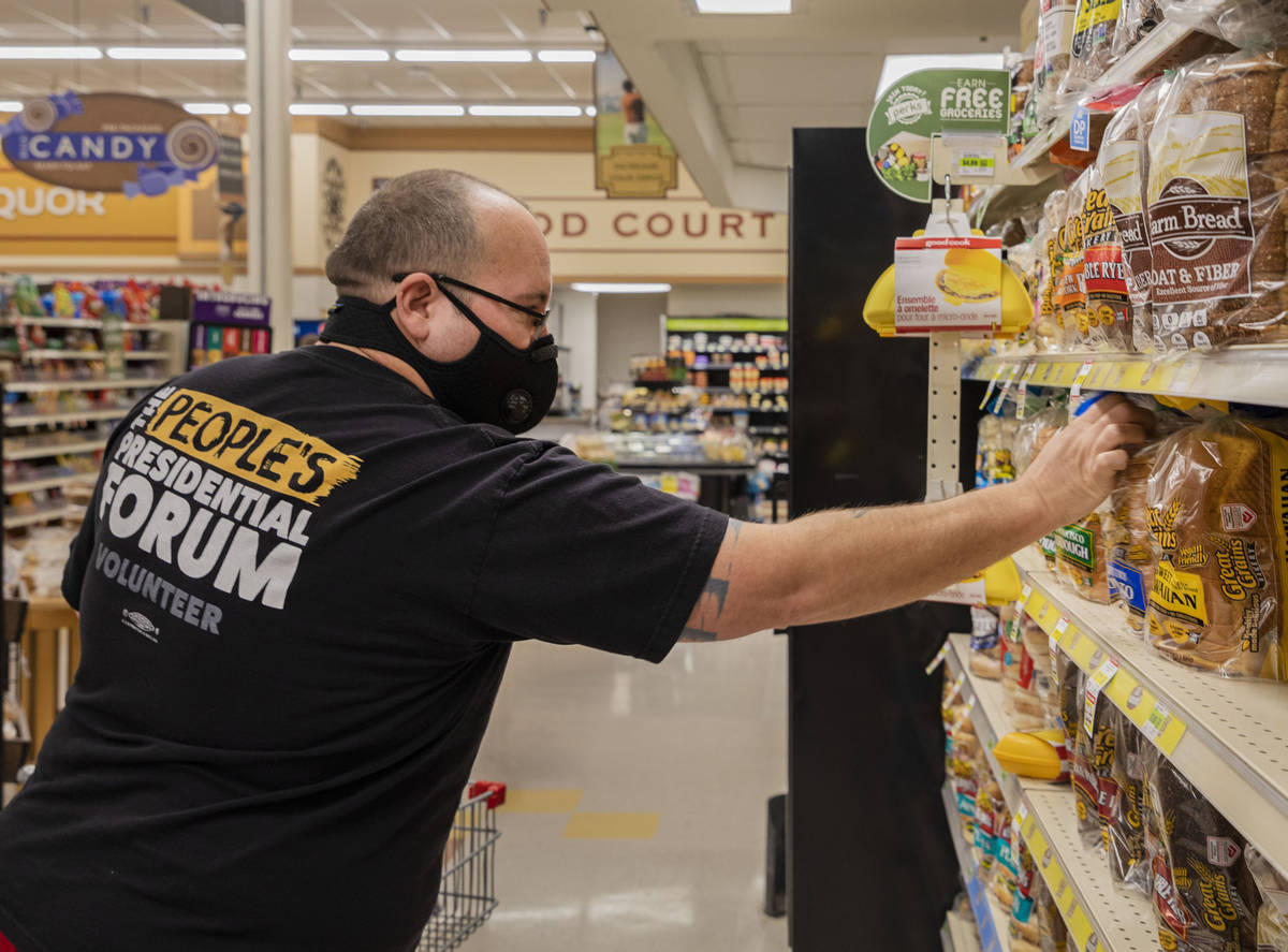 Trinity Tanner, 43, of Overton, gets bread at Lin's Market in Overton on Tuesday, March 24, 202 ...