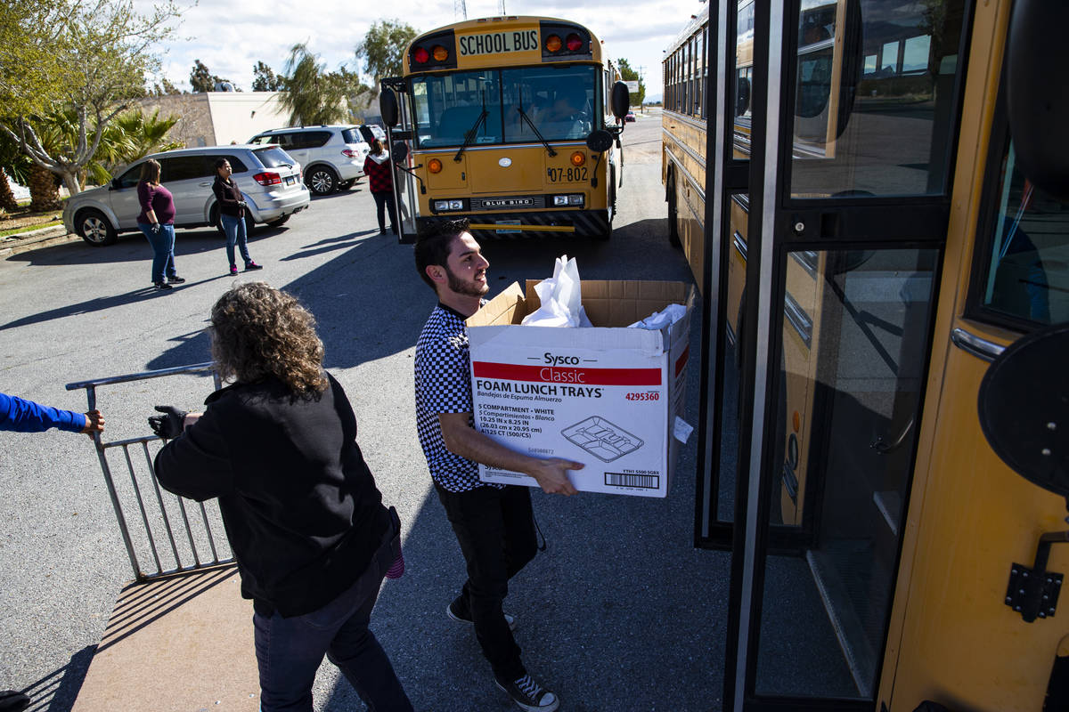 Javier Favela helps load school meals to be distributed to local students at home in Amargosa V ...