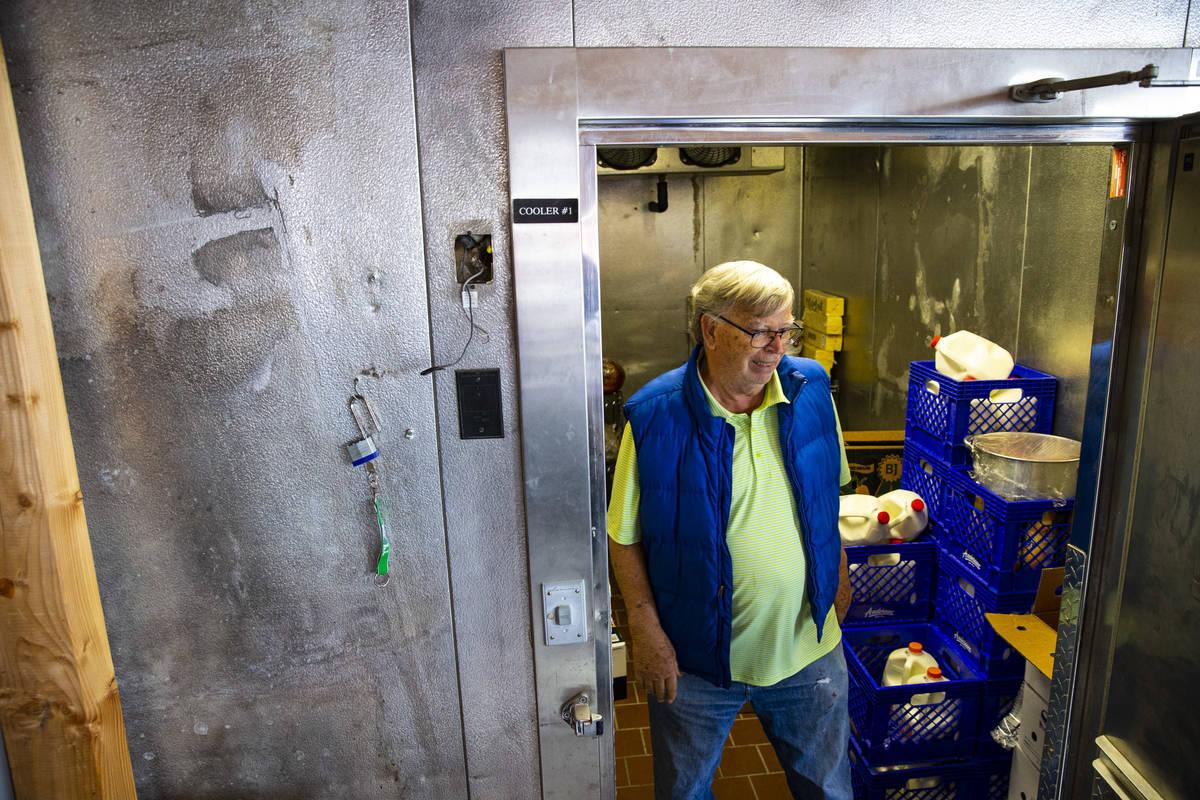 Ed Martell, owner of Martell Market, walks through a refrigerator full of stocked goods in Amar ...