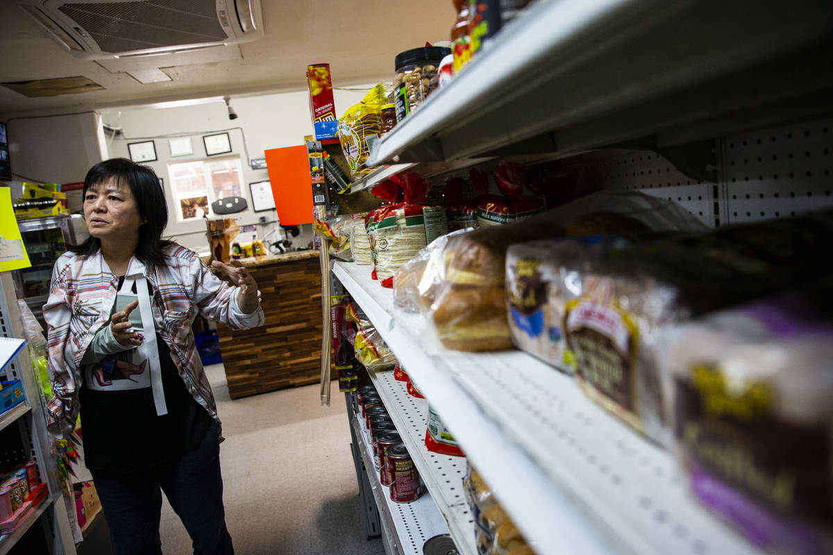 Sunny Martell, owner of Martell Market, shows the different items stocked at the market in Amar ...