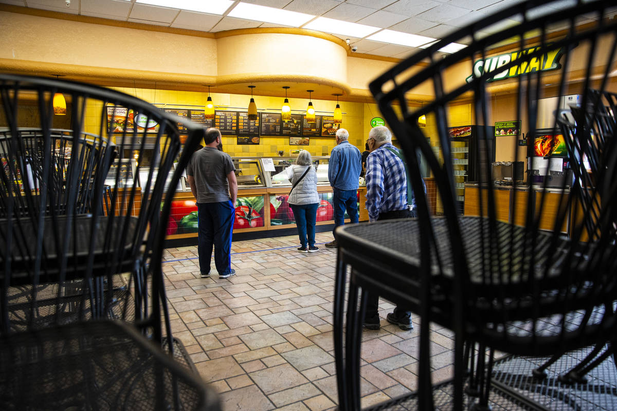 People line up a Subway in Death Valley Nut & Candy Co. in Beatty on Tuesday, March 24, 202 ...