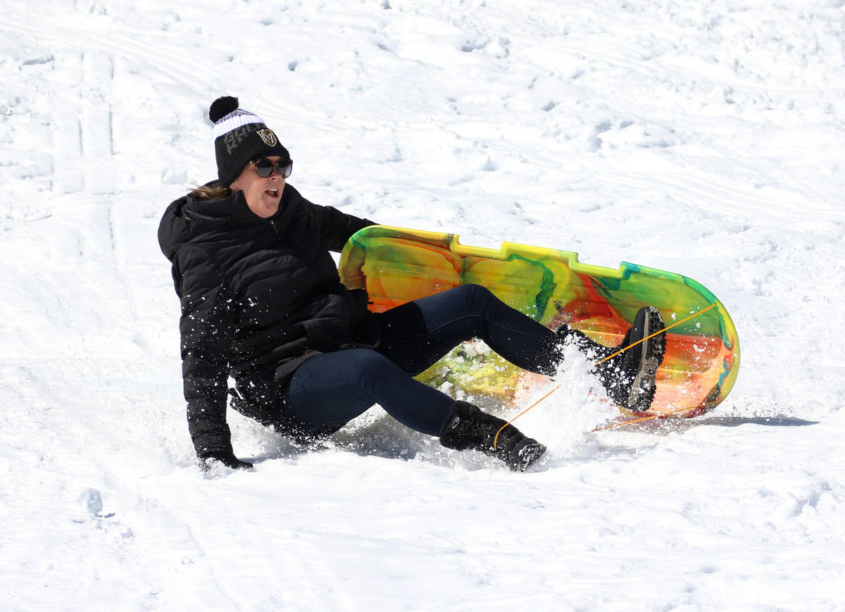 Heather Skovgard of Las Vegas sleds down a hill at Lee Canyon on Tuesday, March 24, 2020. (Bizu ...