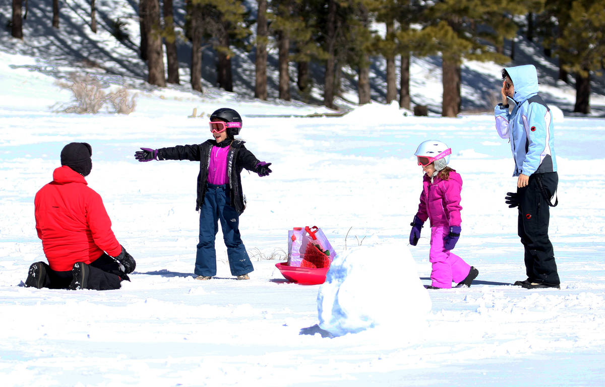 Alan Ravizza of Las Vegas, left, plays with his children Ambra, 7 and Mayra, 5, and his wife, B ...