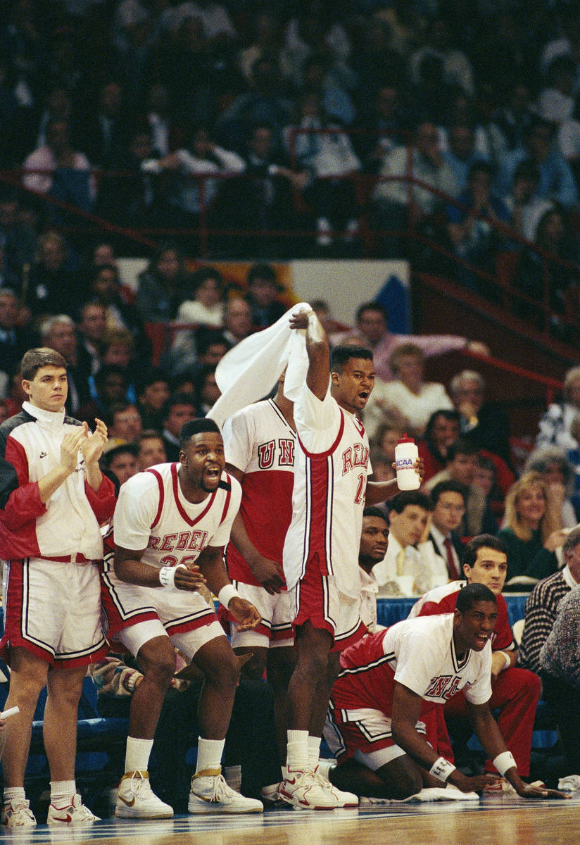 UNLV's Moses Sourry (left) and teammate Anderson Hunt celebrate their team's handling of the Du ...