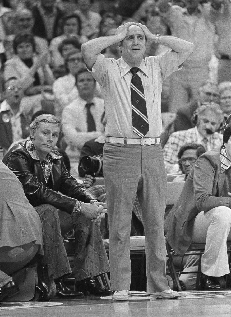 FILE - In this March 26, 1977, file photo, UNLV coach Jerry Tarkanian holds his head in final m ...