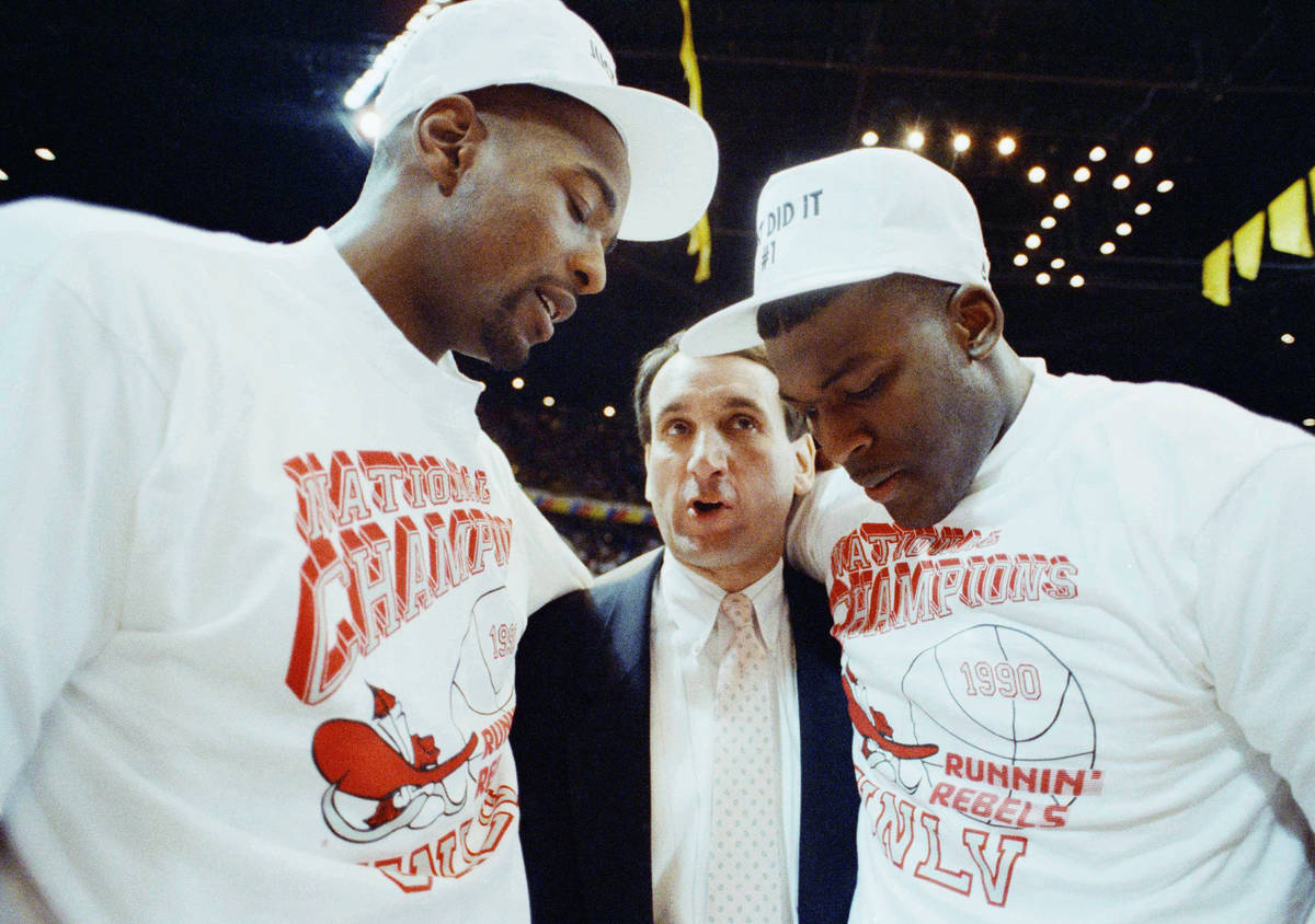 Duke coach Mike Krzyzewsik officer his congratulations to UNLV players Stacey Augmon, left, and ...