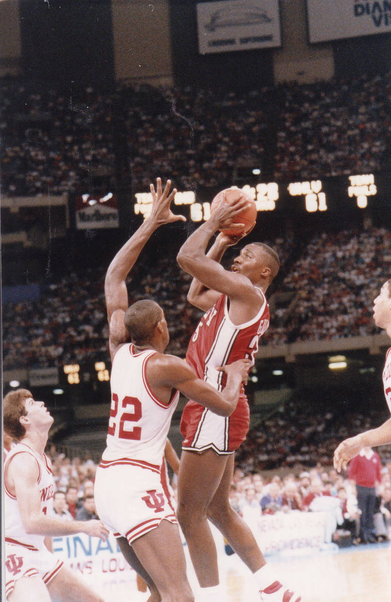UNLV basketball player Armon Gilliam goes up over Indiana players during their NCAA Final Four ...