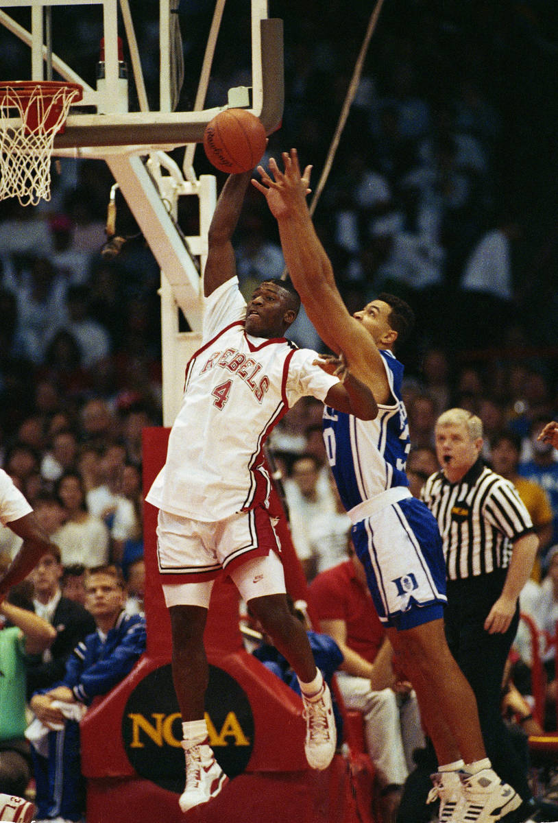 UNLV forward Larry Johnson gets set to fire off a shot beyond the defensive reach of Duke's Ala ...