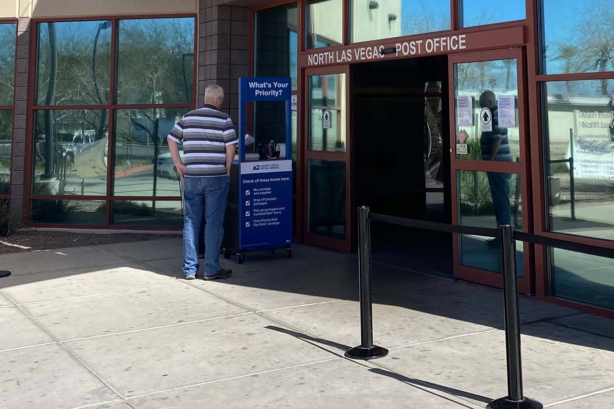 A customers at the U.S. Post Office, 1414 E. Lake Mead Blvd. in North Las Vegas, is greeted Tue ...