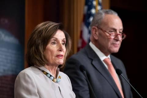 House Speaker Nancy Pelosi of Calif., joined by Senate Minority Leader Chuck Schumer of N.Y., s ...