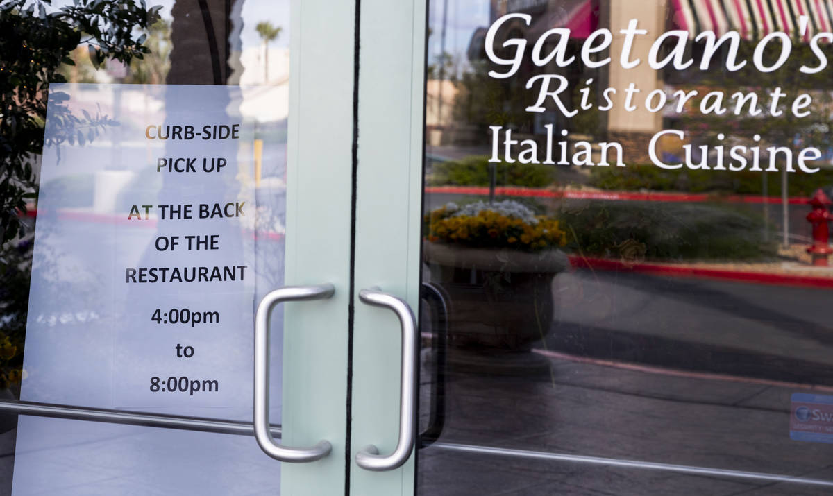 A sign is seen directing customers to the rear of Gaetano's Ristorante for curbside pickup at G ...