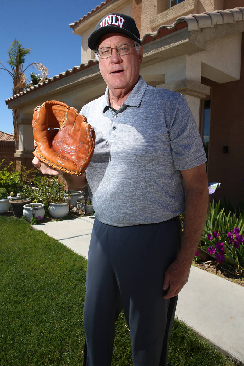 Mike Guerra is photographed with his Hank Bauer model glove at his Las Vegas home, Tuesday, Mar ...