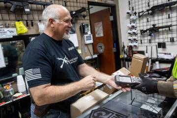 Mark Hames receives a shipment of more gun products at 2nd Amendment Gun Shop on Tuesday, March ...