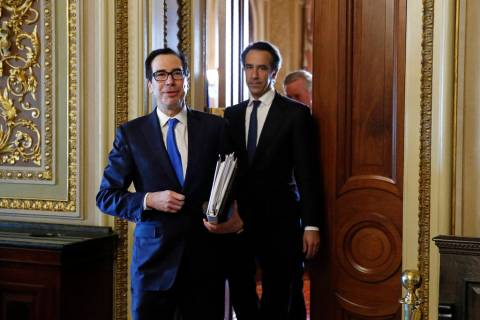 Treasury Secretary Steve Mnuchin steps out of a meeting on Capitol Hill in Washington, Tuesday, ...