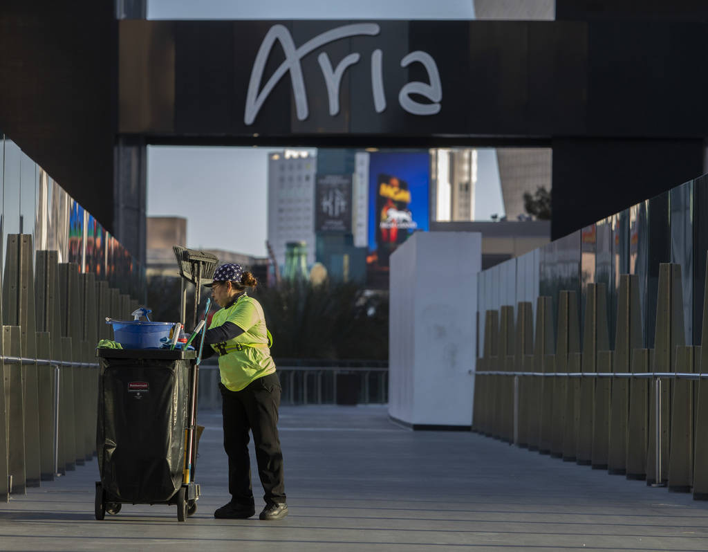 A maintenance employee cleans the pedestrian bridge between Aria and Cosmopolitan on the Strip ...