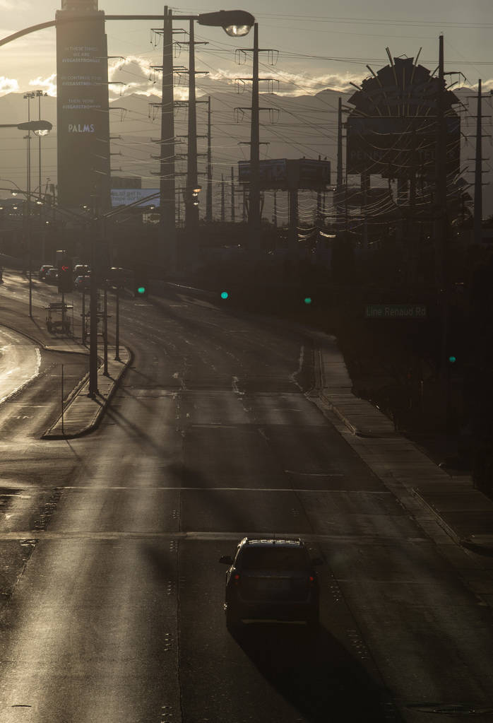 The sun sets on East Flamingo Road on the Strip on Tuesday, March 24, 2020, in Las Vegas. (Elle ...