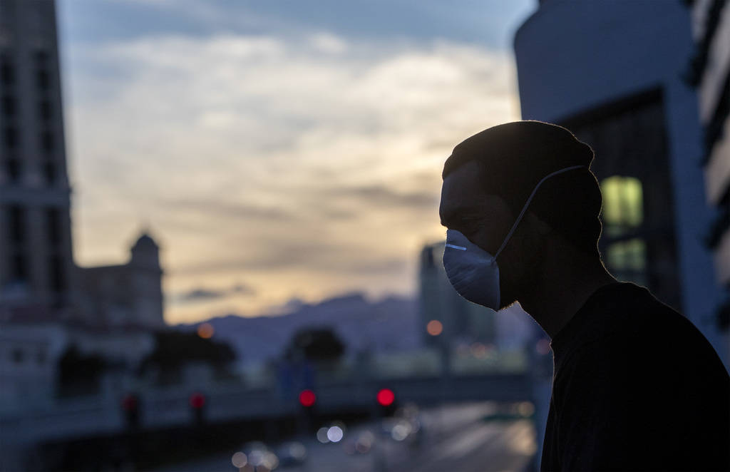 Nick Torres watches the sun set with friends on the Las Vegas Strip on Tuesday, March 24, 2020, ...