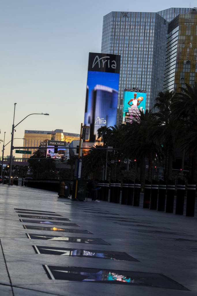 The Aria marquee reflects in the Las Vegas Walk of Stars on Tuesday, March 24, 2020, in Las Veg ...