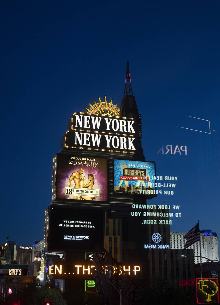 The New York New York marquee shows an MGM message on the Strip on Tuesday, March 24, 2020, in ...