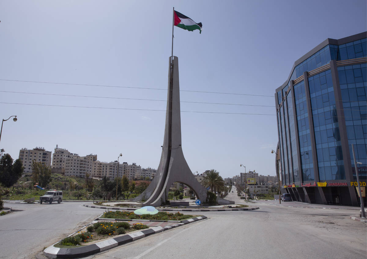 Palestinian security forces deploy to enforce new government measures against the coronavirus, ...
