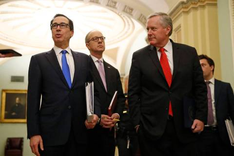 Treasury Secretary Steven Mnuchin, left, accompanied by White House Legislative Affairs Directo ...