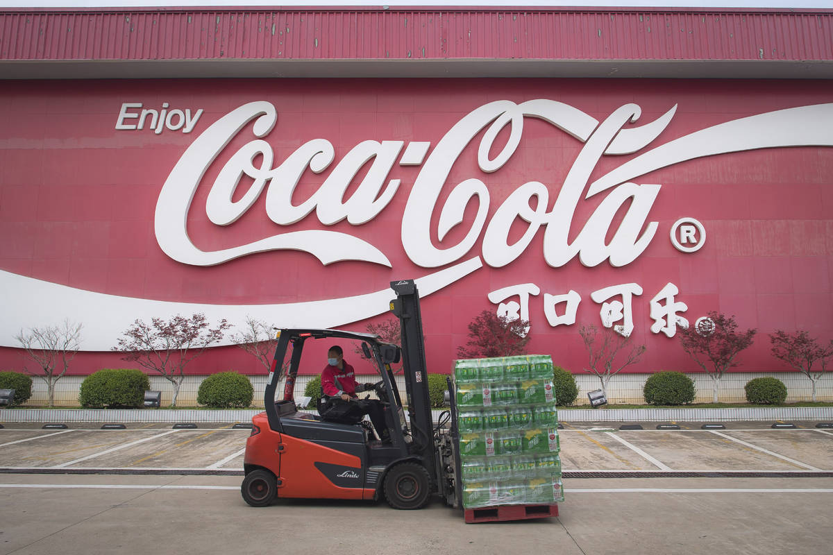 In this Tuesday, March 24, 2020, photo released by China's Xinhua News Agency, a worker wearing ...