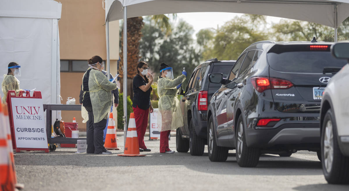 UNLV medicine medical professionals conduct curbside testing on patients experiencing coronavir ...