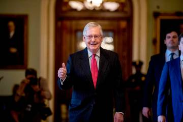 Senate Majority Leader Mitch McConnell gives a thumbs up as he leaves the Senate chamber on Cap ...