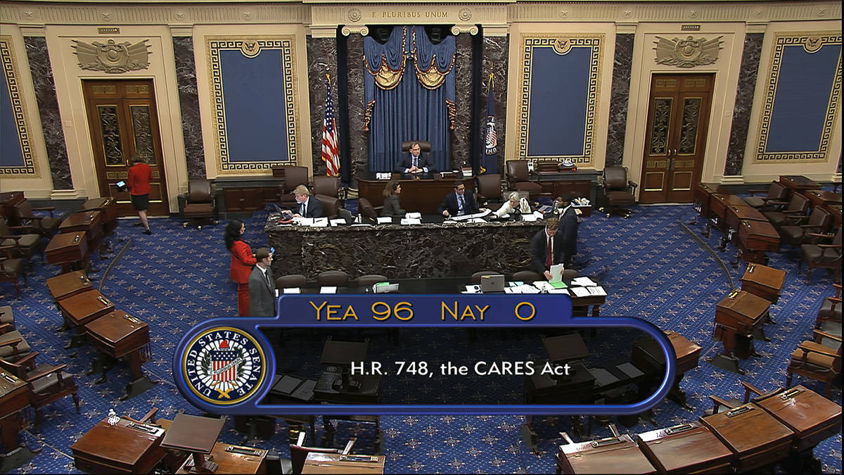 In this image from video, the final vote of 96-0 shows passage of the $2.2 trillion economic re ...