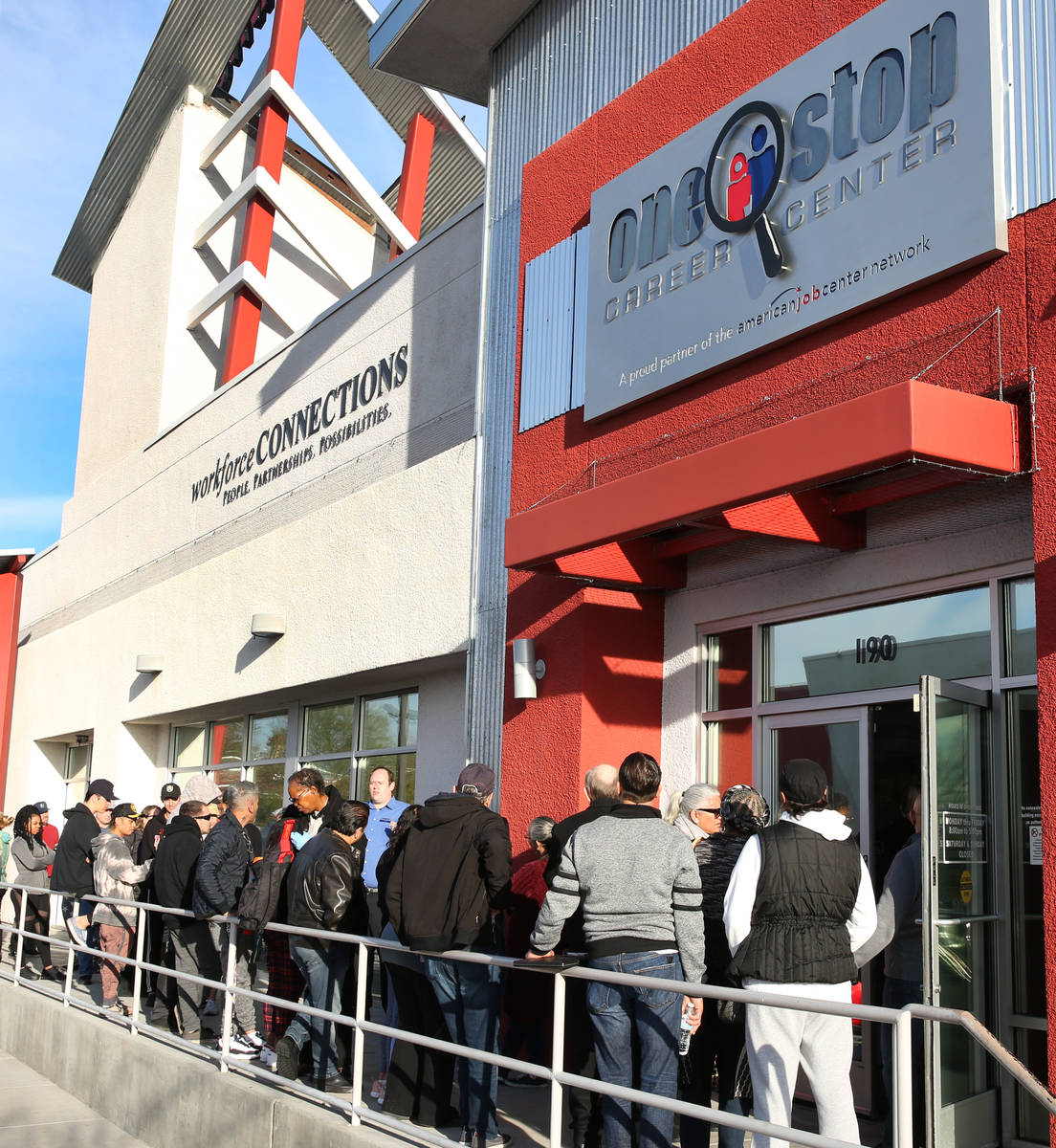 People wait in line at One-Stop Career Center on Monday, March 16, 2020, in Las Vegas. (Bizuaye ...