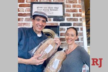 Gio and Naomi Mauro are shown showing off bread loaves at Pizzeria Monzu on Wednesday, March 25 ...