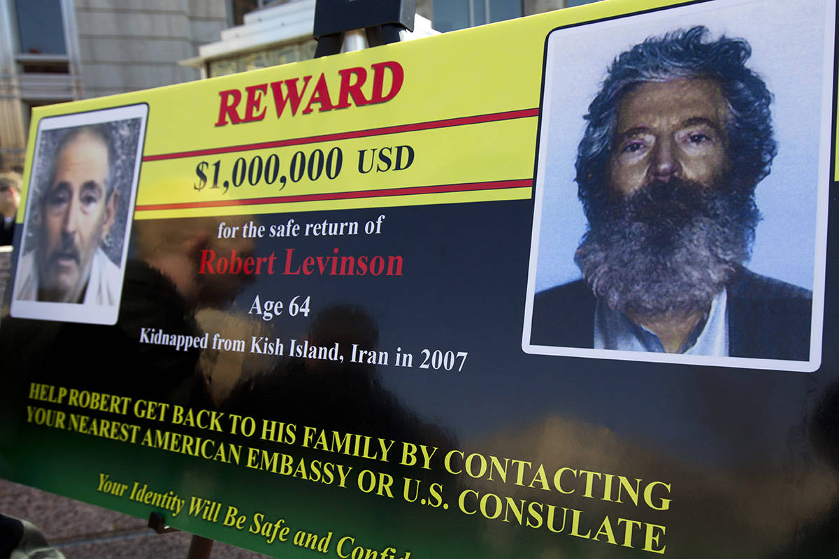 FILE - In this March 6, 2012 file photo, an FBI poster showing a composite image of former FBI ...