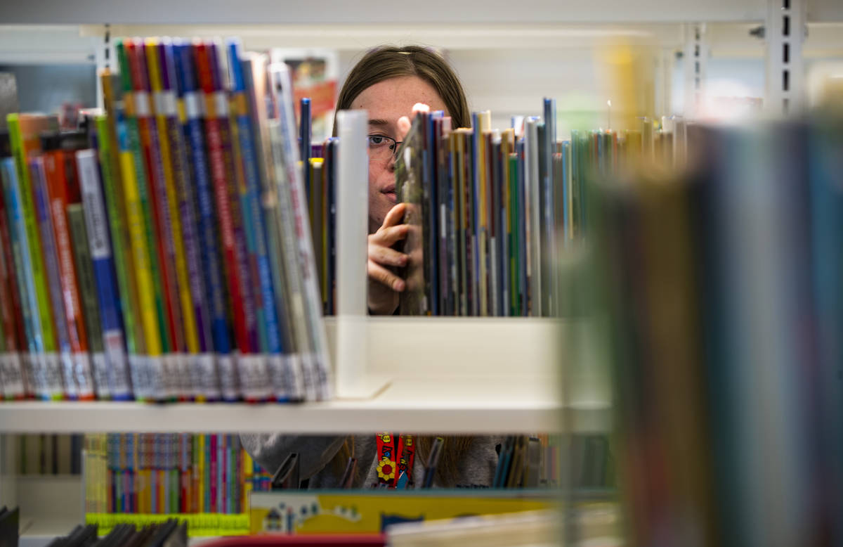 Rachel Hiatt shelves more kids books as work continues on the new East Las Vegas Library, one o ...