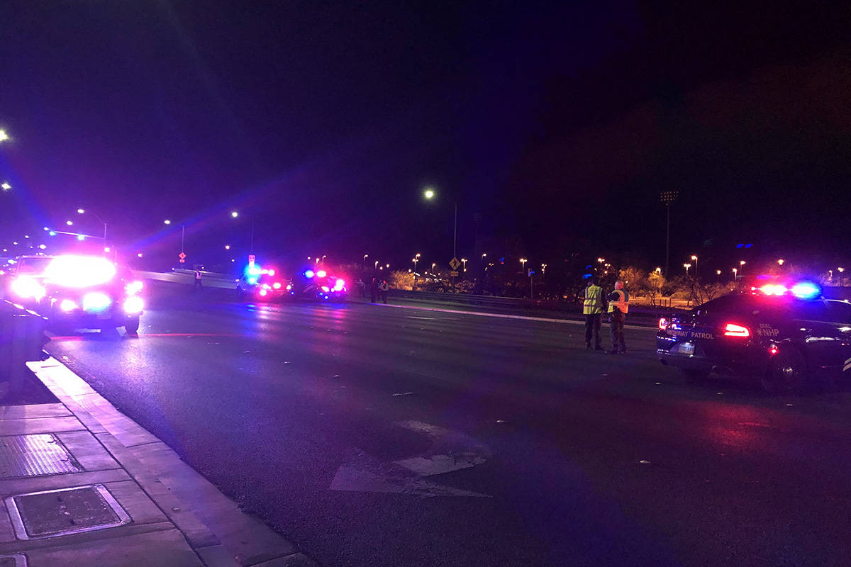 Police investigate a fatal crash involving a pedestrian Wednesday, March 25, 2020, near the int ...