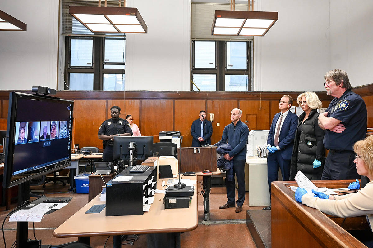 In this photo provided by the New York Unified Court System, Janet DiFiore, foreground third fr ...