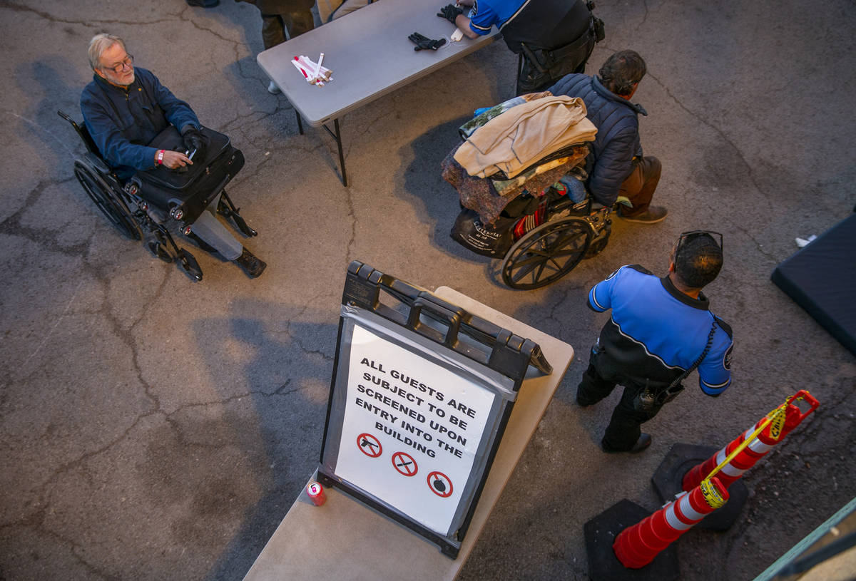 Men are directed to their mats for the night at the Courtyard Homeless Resource Center on Monda ...